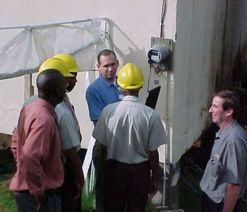 Honeywell's Oscar Dominguez with OHM's Pat Marshall overseeing a meter installation in Castries