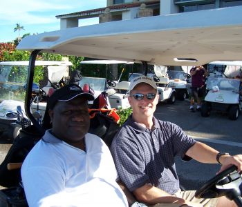 OHM's Lane Peterson with PNG CEO playing golf in Dededo