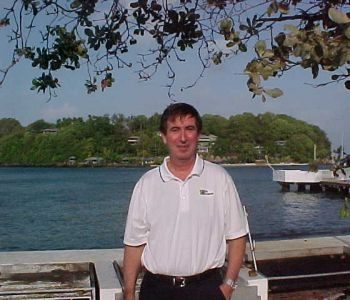 OHM's Pat Marshall in front of Young Island on Villa Beach
