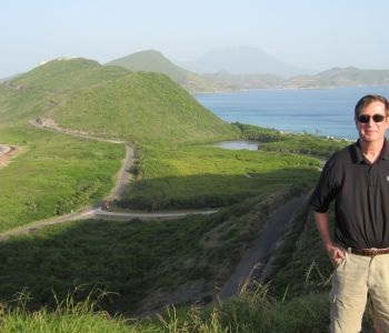 OHM's Pat Marshall high atop St. Kitts with Nevis in background