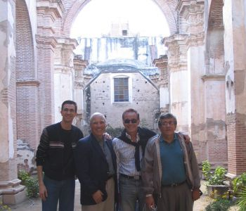 OHM's Pete Gandolfo Jr. with ABB personnel in old Church ruins